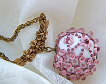 Glass lampwork pendant #2 with small flowers and bronze chain. Pink and violet color. Baroque style.