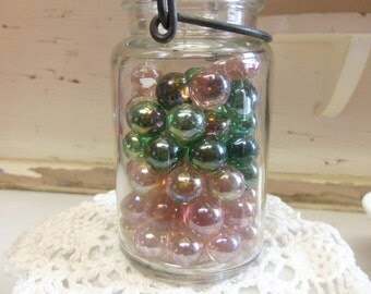 One Vintage Pint Sized Clear Glass Canning Jar filled with Pink and Green Lustre Marbles