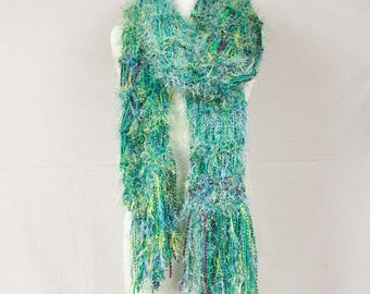 Oversize fashion scarf In a luscious blend of  soft greens Off white Earthy brown 110 inches long 12 inches wide including fringe