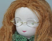 Waldorf doll with auburn hair and knitted cardigan