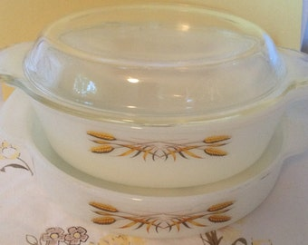Set of two golden wheat pattern casserole dishes.  One with lid.