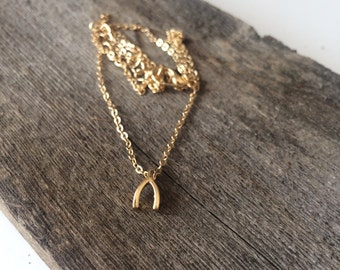 Wishbone Pendant on a Gold Chain Necklace