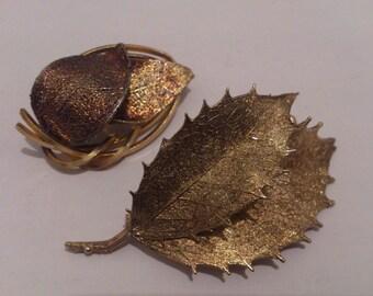 two vintage leaf design brooches