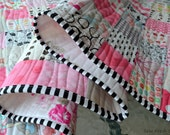 Baby Girl Quilt for sale, modern patchwork blanket, nursery bedding, prints, flowers, blooms, pretty, pink, black and white striped binding