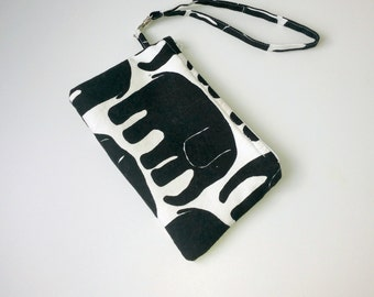 Black and white little pouch With removable wristlet strap Black and white cotton with lining and zipper ready to ship Washable Comfortable