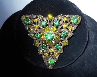 unique signed selini brooch-stones set among leafy foliage -unusual triangle shape-beautiful green stones-wonderful vintage piece