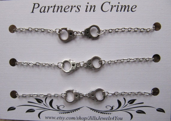 partners in crime bracelet with handcuff charms 3