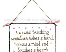 A Special Teaching Assistant Takes A Hand Opens A Heart And Touches A Heart Hanging Metal Wall Plaque Sign