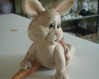 Ceramic Easter bunny  baby crawling w carrot & pink diaper.