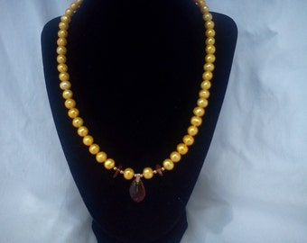yellow pearl and fossil amber necklace