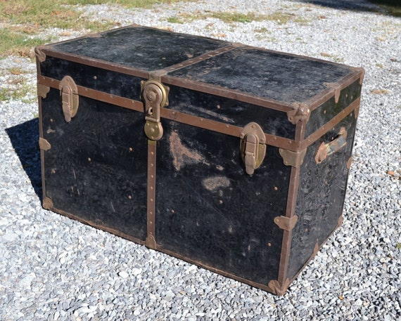 Sold vintage metal trunk black coffee table storage photo prop Metal chest coffee table
