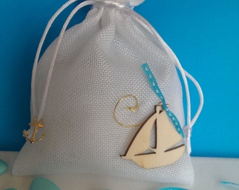 White fabric pouch with wooden boat - baptism favor, bomboniere