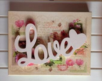 LOVE written in wood