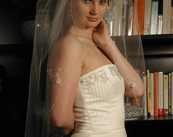 """This veil is 34"""" long and 72"""" wide. Hand beaded flowers and beaded scallop edge."""