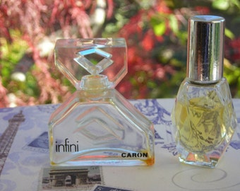 2 vintage Caron Infini miniature perfume bottles. 1 empty, and 1 that is 75% full.