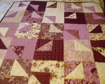 Lap quilt in plum and cream assorted fabrics, hand quilted