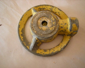 retro lawn sprinkler-garden-flower beds-rustic-yellow cast iron-chipped paint-tarnished metal-