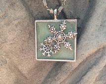 Spring Snow Glowing Necklace - Glow in Dark Pendant, Silver Plated Snowflakes and Byzantine Chain, Square Modern Bezel