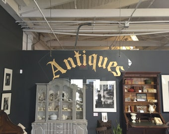 """Hand Made Glass """"Antiques"""" Sign Used in a Commercial"""