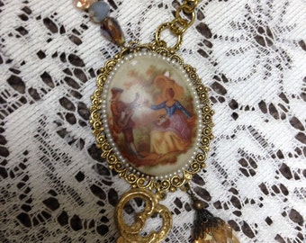 Vintage assemblage cameo gold tone beaded (blue,peach,brown) necklace w/key charm; upscaled,repurposed,mixed media,altered art, iridescent
