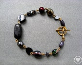Roxy - bracelet with gold plated toggle clasp, pearl, glass, agate, marble - All donated to animal charity