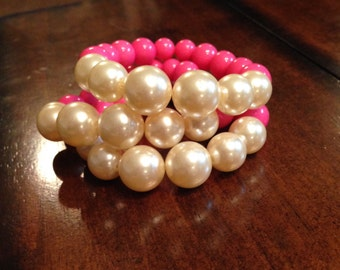 Hot pink and pearl stack bracelets