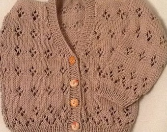 Hand knitted traditional baby girls cardigan