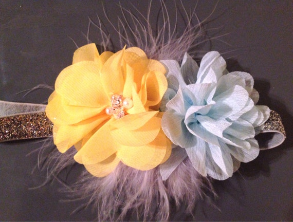 Gorgeous over-the-top glitter elastic feather and bling headband