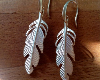 Matte gold plated feather earrings