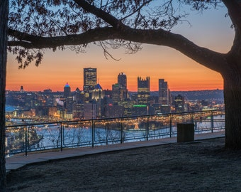 A tree frames the Pittsburgh skyline at dawn from the West End Overlook - Metal Print