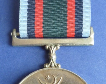 Original Pakistan 1965 Military Campaign Medal. (The Tamgha-I-Jang Medal). Very Nice Condition.