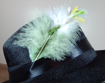 White orchid feather hat pin with green caviar glitter