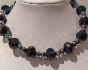 Necklace. 36cm Features Large Crystal Faceted beads. Followeby Silver metallic Crystal faceted