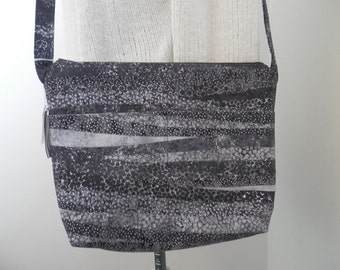 Black and grey purse with two outer pockets, a zipper closure, and is fully lined.