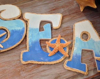 Big hand painted sea letters