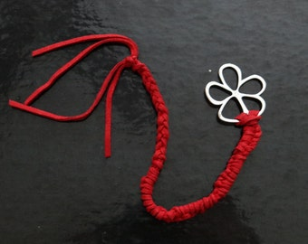Stunning Red leather weaved bracelet with flower motive in steel that serves as a lock