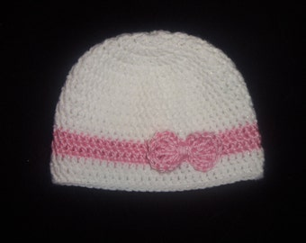 Crocheted Sparkly White Baby Hat With Pink Bow