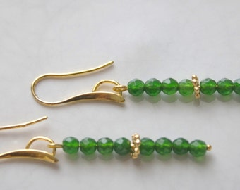 Gold earrings with  green jade beads