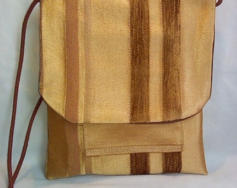 golden tapestry pocket purse with choc brown lining