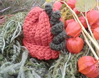 Infant pumpkin hat in rich fall colors.