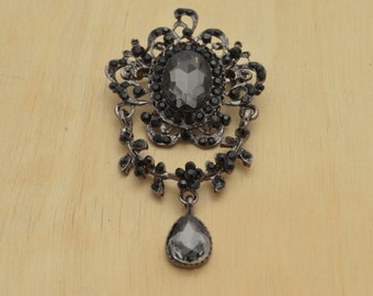 Camile's Gothic Brooch with Dark Rhinestones. Dangeling Element and Acrylic Stones and Intricate Metal Details