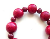 INFINITE HOPE Stretch bracelet made from deep red ceramic and acrylic beads and a metal HOPE charm
