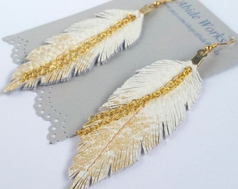 BEST SELLERS White and gold Leather Feather Earrings