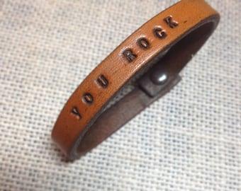 Super skinny leather wrist band.