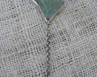 Dolomite stones clasped in Silver