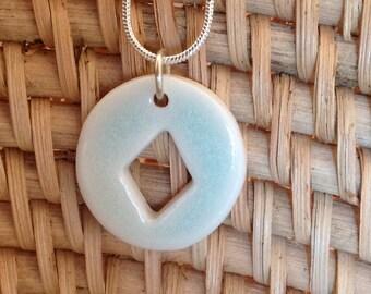 Celadon porcelain pendant on a silver snake chain