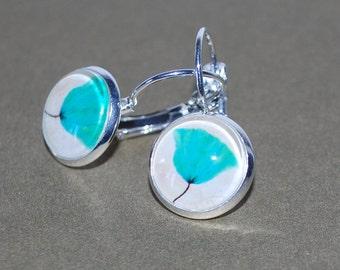 Earrings dangling blue flower