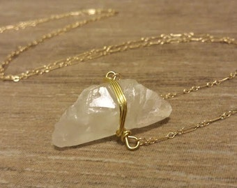 Wire Wrapped Raw Quartz Crystal on a 14k Gold Filled Chain.