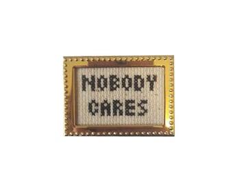 Nobody Cares framed cross stitch