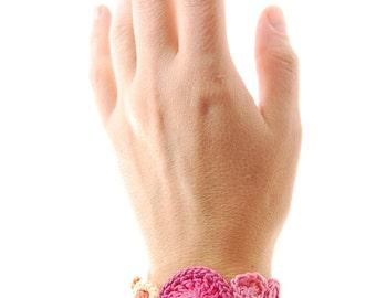crochet cuff bracelet in citrus orange and blush pink handmade by Even Howard. Women's fiber art bracelet.